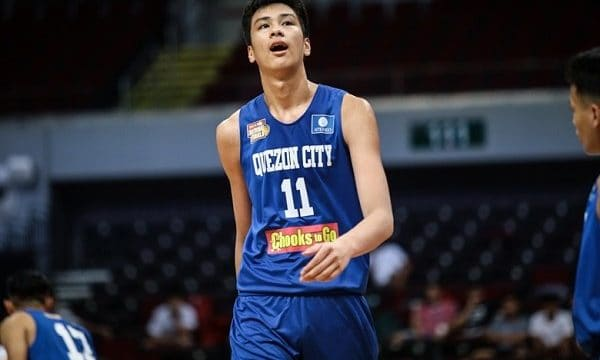 Kai Sotto on the court playing for Quezon City in the Philippines